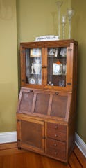 A curio cabinet and secretary in the dining room. May 20, 2019