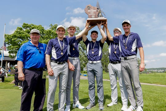Roncalli coach John Haug and players, from left, Will Falconer, Luke Pautz, Bryce Pautz, Ethan Wheelis and Ian Behringer celebrate after the Jets won the WIAA Division 3 state golf championship Tuesday in Madison.