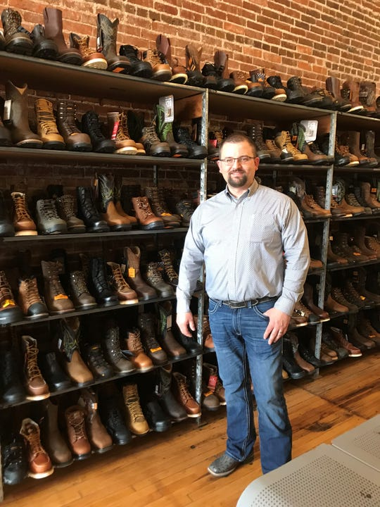 Chris Troupe, owner of The Boot Life,said he sees growth in local retail and manufacturing jobs.