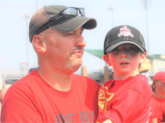 Shelby boys track coach Chris Zuercher with his son, Bennett, after the Whippets won the Division II state championship last Saturday in Columbus