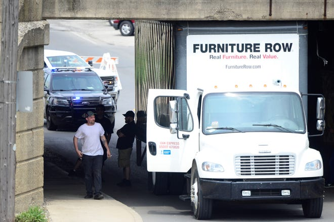A box truck was stuck underneath the overpass that covers Park Avenue East, blocking the westbound lane of U.S. 42 on June 4, 2019.