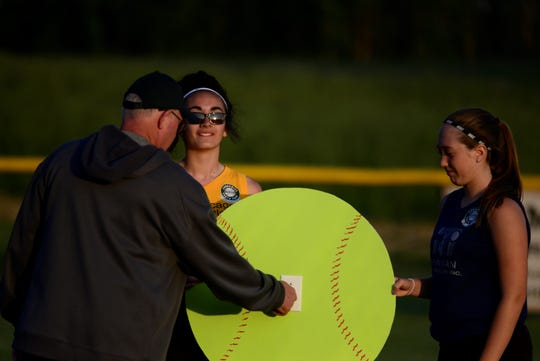 Wayne Lautzenhiser, fundraiser chairman, throws the switch to turn on new lights for one of Madison Youth Community Park's softball fields on June 3, 2019.