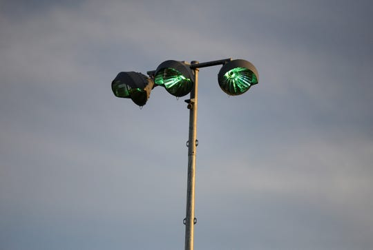 The new lights begin to turn on at one of the softball fields at Madison Community Youth Park on June 3, 2019.