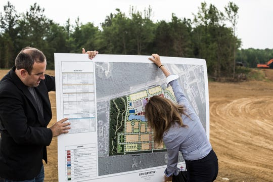 Wesley Wright, commissioner at Lakeland, left, and Maggie Gallagher, Director of Development for The Lake District, are seen before the start of a media event talking about The Lake District development on Tuesday morning, June 04, 2019.