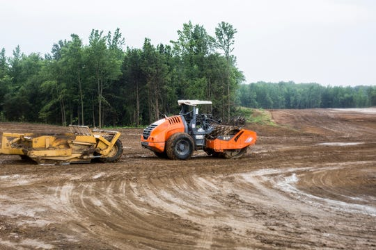 Construction equipment is seen during a media event about The Lake District development Tuesday morning, June 04, 2019.