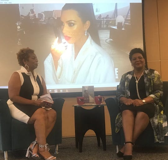 "Alice Marie Johnson, right, joins Faith Morris, chief marketing and external affairs officer of the National Civil Rights Museum, to discuss her book, ""After Life."" Johnson was the museum's Catalyst for Change speaker. A clip of Kim Kardashian calling Johnson to tell her she was free is in the background."