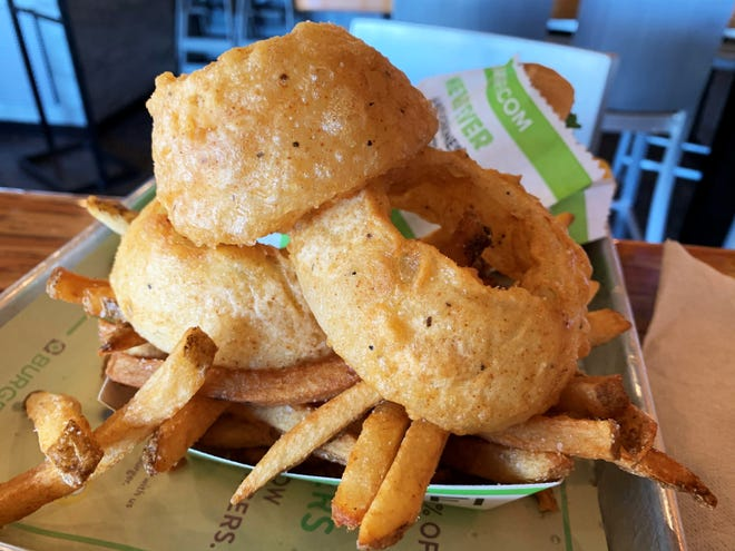 "The ""Cry + Fry"" a blend of hand-cut fries and double-battered onion rings from BurgerFi."