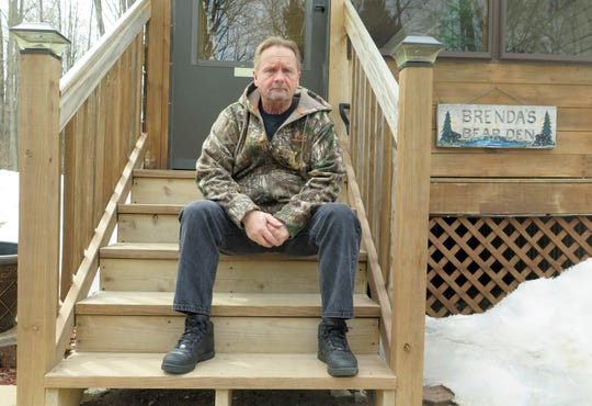 Wayne Sankey sits on the front steps of his Lakewood home April 10. He is the neighbor of Raymand Vannieuwenhoven and says he was stunned by the arrest of the 82-year-old handyman in the 1976 murders of David Schuldes and Ellen Matheys.