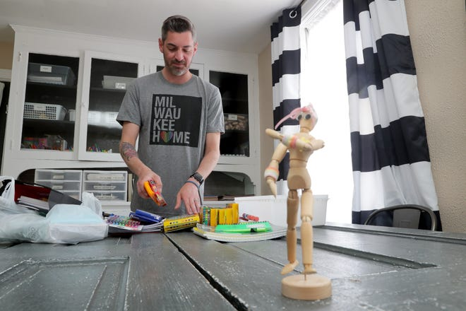 Nick Schlaikowski a founder of Courage MKE, organizes art supplies at  the second Courage House that will be used as an art studio at the Courage MKE Courage House in Milwaukee on Tuesday, June 4, 2019.