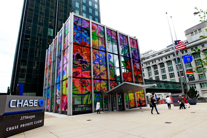 """Chicago artist Carlos Rolón's """"Gild the Lily (Caribbean Hybrid I, II, III),"""" his transformation of the Chase Bank lobby cube at N. Water St. and E. Wisconsin Ave., will remain on view for Sculpture Milwaukee 2020."""