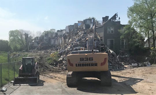 Demolition crews began tearing down a 62-unit building in the White Oaks apartment complex on Monday, June 3.