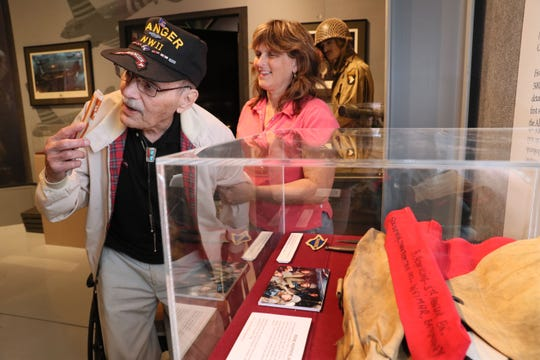 "Rene ""Kep"" Kepperling, 93, and his daughter, Pollyanna Hintz, both of Fond du Lac, get a private look at a new exhibit called D-Day Plus 75 at the EAA Aviation Museum in Oshkosh.  Kepperling donated some of the items in the display case at right including a captured German flag. Kepperling was an Army ranger, who climbed Pointe du Hoc near Omaha Beach on D-Day.  The exhibit opens on to the public on June 6."