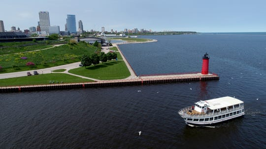 The Vista King tour boat makes it's way past the Pierhead Lighthouse back to the Milwaukee River from Lake Michigan in Milwaukee on Monday, June 3, 2019. Photo by Mike De Sisti and Jim Nelson/Milwaukee Journal Sentinel