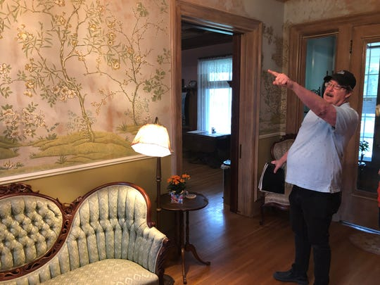 Innkeeper Stuart Koehler shows off some of the original wallpaper at the Ringling House Bed & Breakfast in Baraboo, which was built for Charles Ringling in 1900 by the Isenberg brothers, immigrants from Germany who were skilled woodworking craftsmen.