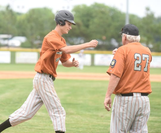 Will Uchtman is congratulated by coach Lester White after hitting a home run last season.