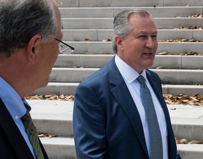 Former Alabama Speaker of the House Mike Hubbard leaves court on the steps of the Alabama Supreme Court in Montgomery, Ala., on Tuesday, June 4, 2019.