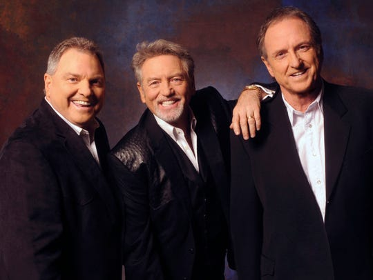 From left, Steve Gatlin, Larry Gatlin, and Rudy Gatlin of the Gatlin Brothers perform Sunday at the Montgomery Performing Arts Centre.