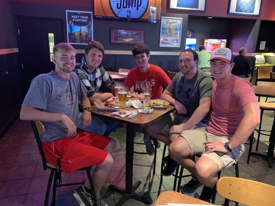 Jared Coats, left, Jacob Walters, Doug Burgess, Collin Hoots and Bret Lawson watch the 2019 MLB Draft at Buffalo Wild Wings.
