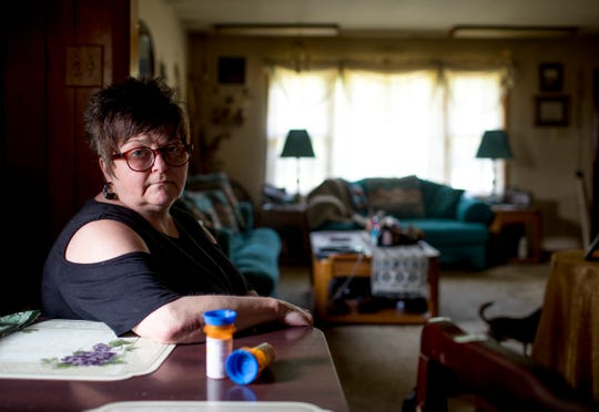"Dana Hampton, a former patient of Rinova Pain Clinics that was abandoned when her clinic in Clarksville shut down suddenly last month, is shown with what could be her last supply of medication at the Hampton household in Cerulean, KY., on Monday, June 3, 2019. With a dwindling supply of pain medication and no way to access her medical records, getting a new pain doctor will be challenging. ""We're tired of having to start over,"" Hampton said about being stuck needing to get new doctors. ""This isn't about opioid abusers,"" she said. ""It's about patients abandoned by doctors."" Hampton said she may need to start rationing the supply while she and her husband look for a new doctor."