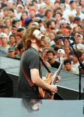 Trey Anastasio of Phish plays his guitar to an estimated 60,000 fans Saturday, Aug., 15, 1998 at the Lemonwheel festival.