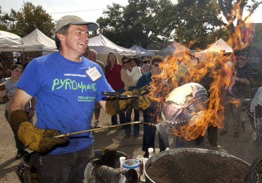 Bruce Odell demonstrates Raku pottery firing at the American Artisan Festival.