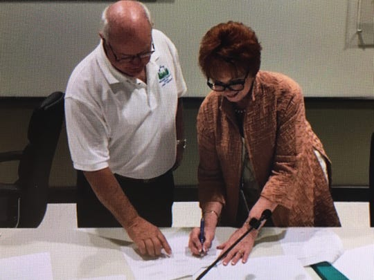 Donna Wright, signs a contract extension on June 3, 2019, after board approval.