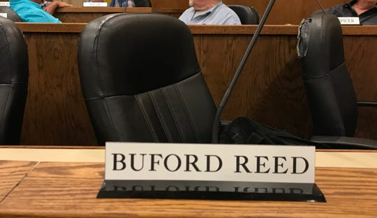 Booty Reed's spot in the Dickson County Commission Chamber on Monday night following Reed being honored at NHC in Dickson.