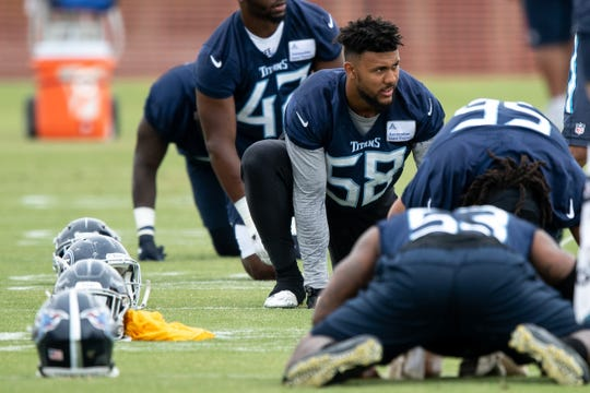 Tennessee Titans linebacker Harold Landry (58) stretches during an organized team activity at Saint Thomas Sports Park  in Nashville, Tenn., Tuesday, June 4, 2019.