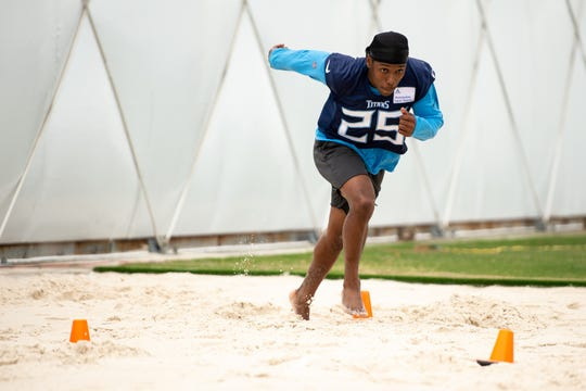 Tennessee Titans cornerback Adoree' Jackson (25) runs drills in the sand pit during an organized team activity June 4, 2019, at Saint Thomas Sports Park in Nashville.