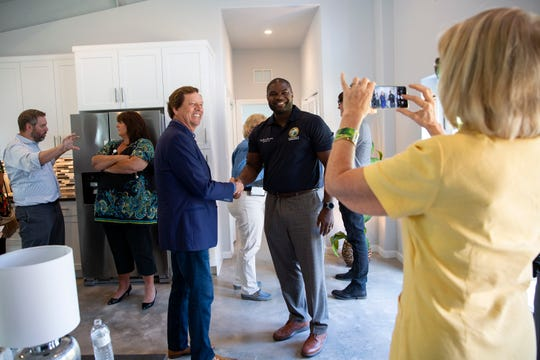 Jim Henderson, president of JLH Sustainable Housing shakes hands with state Rep. Byron Donalds, R-Naples, during an open house event, Tuesday, June 4, 2019, in East Naples.