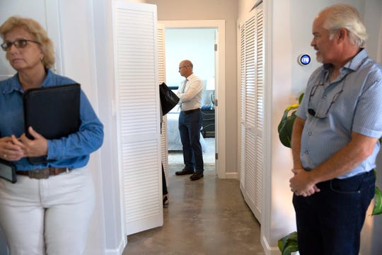 Community members tour an environmentally friendly home, built by JLH Sustainable Housing, during an open house event, Tuesday, June 4, 2019, in East Naples.