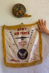 A remnant from Eugene Roberts' time in the Air Force during World War II hangs on the wall at his home in Naples on Saturday, June 1, 2019.