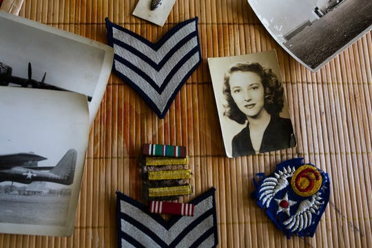 Remnants from Eugene Roberts' time in the Air Force during World War II are displayed on the table of his home in Naples on Saturday, June 1, 2019.
