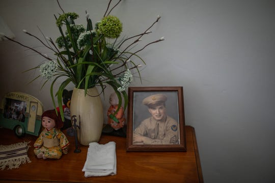 A photo of Eugene Roberts while he was in the Air Force during World War II is displayed at his home in Naples on Saturday, June 1, 2019.