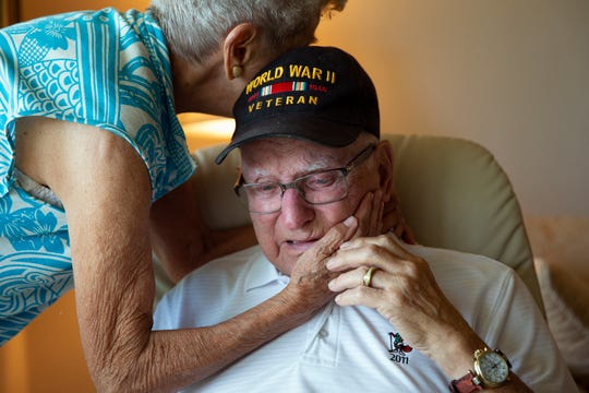 "World War II and D-Day veteran Chester Sokol is comforted by his wife, Dolores ""Dolly"" Sokol after recalling his first time experiencing the effects of post-traumatic stress disorder during an interview, Monday, June 3, 2019, at his home in East Naples."