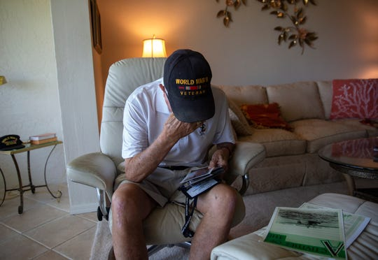 World War II and D-Day veteran Chester Sokol breaks down as he remembers the names and faces of the soldiers who didn't survive the war during an interview at his home, Monday, June 3, 2019, at his home in East Naples.