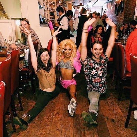 Guests show off their splits at La Pulperia's drag brunch.