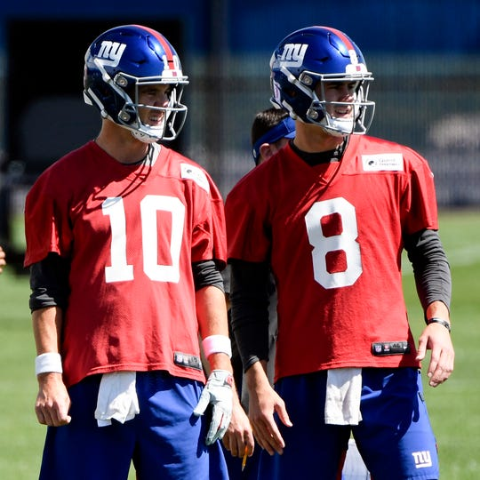 New York Giants quarterbacks Eli Manning (10) and Daniel Jones (8) practice on Day 1 of Giants minicamp on Tuesday, June 4, 2019, in East Rutherford.