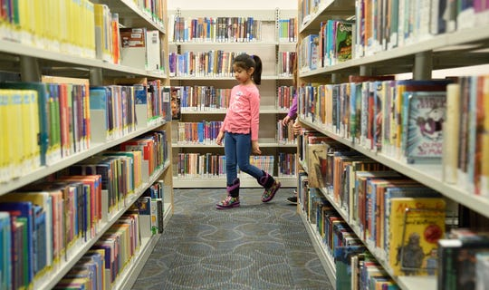 Navya Shrivastava, 9, of Clifton School 9, looks for books at the Allwood Library in Clifton.