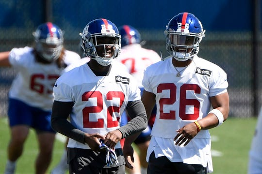 New York Giants running backs Wayne Gallman Jr. (22) and Saquon Barkley (26) on the field for Day 1 of Giants minicamp on Tuesday, June 4, 2019, in East Rutherford.
