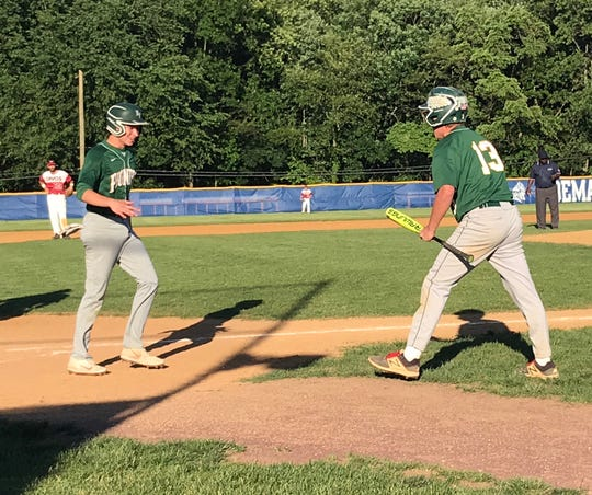 New Providence runner Jeffrey Policarpio is greeted by Nate Scott (13) after scoring to tie Monday's Group 1 baseball semifinal, 7-7 in the seventh inning, against Emerson at NV/Demarest.