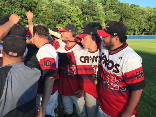 "Emerson relief pitchers Justin Roa (22) and Bryan Atkinson (with ""Golden Gamer"" award) join the postgame huddle after the Cavos defeated New Providence, 9-8, in eight innings Monday in the Group 1 baseball semifinals."