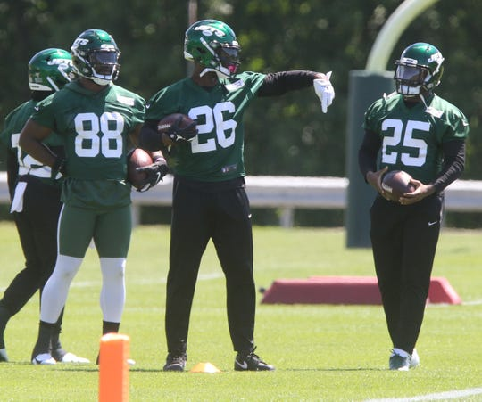 Running backs Ty Montgomery with the newest Jet, Le'Veon Bell and fellow running back Elijah McGuire as they work through drills during the first day at the New York Jets minicamp in Florham Park, NJ on June 4, 2019.