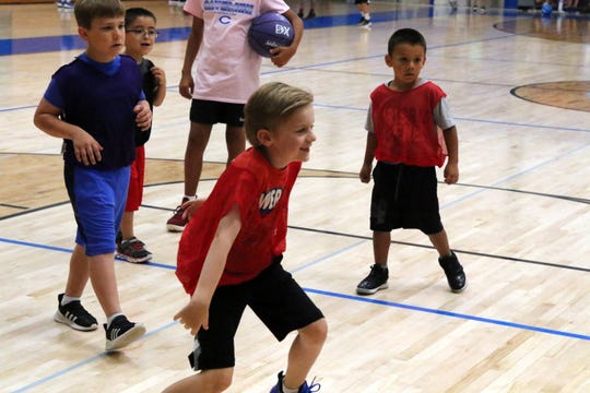 Lee Majerus, 7, plays lock-down defense  as a member of the ACC division during Tuesday's portion of the 2019 Cavemen boys basketball summer camp at CHS. The camp filled its max limit of 135 athletes who attended.
