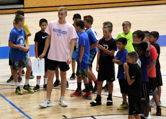 Caveman varsity player Evan Sullivan speaks to his campers, the Mountain West Conference, during Tuesday's portion of the 2019 Cavemen boys basketball summer camp inside CHS. The camp filled its max limit of 135 athletes who attended.