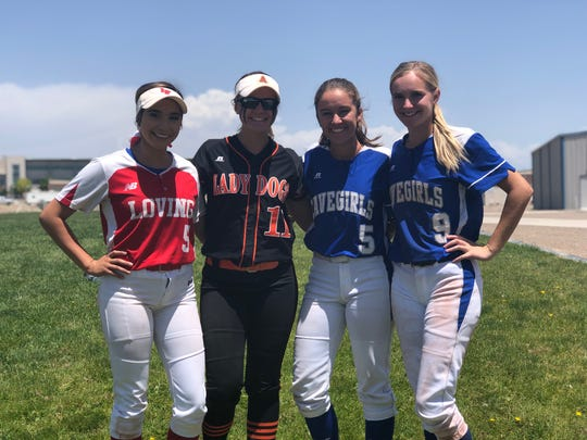 Left to right: Loving's Anyssa Rodriguez, Artesia's Melody Payne and Carlsbad's Gabby Aragon and Jennifer Munro pose during a break in the 2019 NM All-Star softball tournament in Rio Rancho.