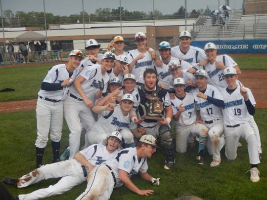 The Livonia Stevenson baseball team celebrates its 2019 district championship.