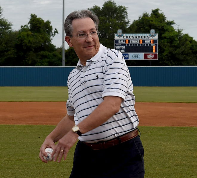 Michael Doucet throws out the first pitch at Opelousas' American Legion game.