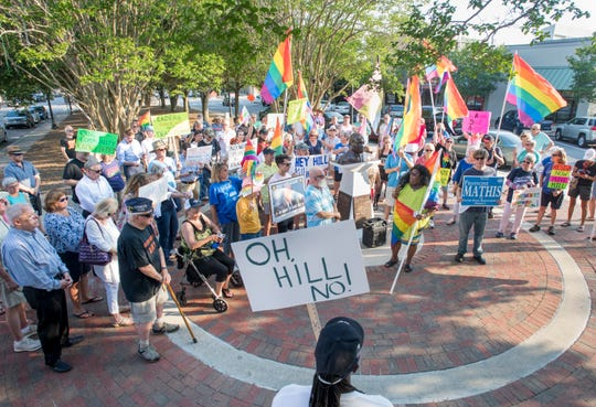 A crowd gathers at an anti Mike Hill rally in downtown Pensacola on Monday, June 3, 2019.  The protesters are calling for the resignation of State Rep. Mike Hill after he made light of a suggestion that he enact legislation that would enforce the death penalty for homosexuality.
