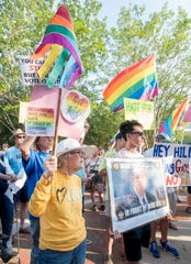 Marcy Moreland, left, and others participate in an anti Mike Hill rally in downtown Pensacola on Monday, June 3, 2019.  The protesters are calling for the resignation of State Rep. Mike Hill after he made light of a suggestion that he enact legislation that would enforce the death penalty for homosexuality.